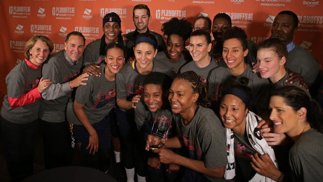 The Indiana Fever posed with their trophy after defeating the New York Liberty in Game 3 of the WNBA basketball Eastern Conference finals at Madison Square Garden in New York on Sept. 29.