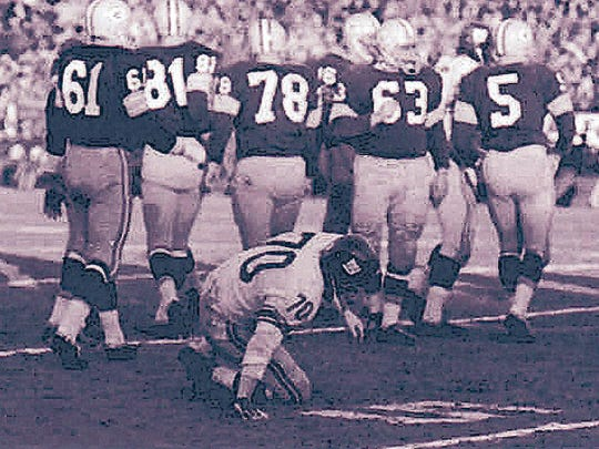 Packers players walk away as New York linebacker Sam Huff gets up slowly during Green Bay's 37-0 victory over the Giants in the NFL championship game at new City Stadium on Dec. 31, 1961. From left, the Packers players include Nelson Toburen (61), Lee Folkins (81), Norm Masters (78), Fuzzy Thurston (63) and Paul Hornung (5). Press-Gazette archives