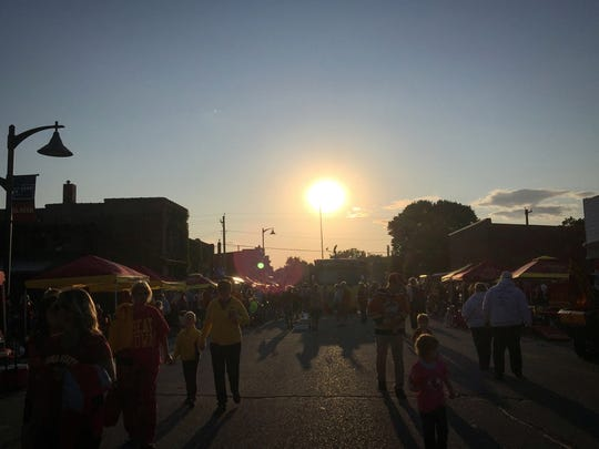 The sun sets over Main Street in downtown Slater during the Sept. 5 Cy-Hawk street party as part of RVTV.