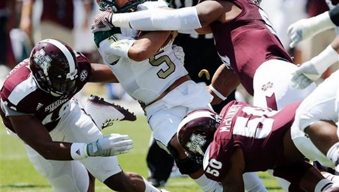 Mississippi State's Preston Smith sacks UAB quarterback along with Benardrick McKinney and Ryan Brown.