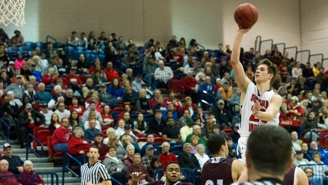 USI's Alex Stein (20) goes up for a basket in the first half of the game at USI's PAC arena in Evansville, Ind. Thursday night, Feb. 25, 2016.
