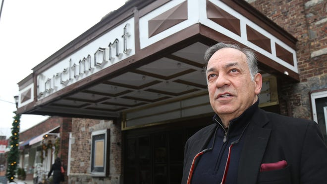 Michael DiCosimo from Bronxville, pictured in front of the Larchmont Playhouse, wants to purchase the theater on Palmer Avenue in the village.