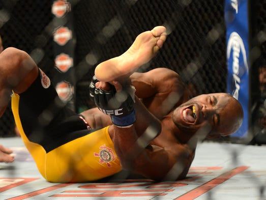 Anderson Silva reacts after breaking his leg on a kick to Chris Weidman (not pictured) during their UFC middleweight championship bout at the MGM Grand Garden Arena.