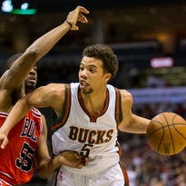 Milwaukee Bucks guard Michael Carter-Williams (5) drives for the basket as Chicago Bulls guard E'Twaun Moore (55) defends during the fourth quarter at BMO Harris Bradley Center. Milwaukee won 95-91.