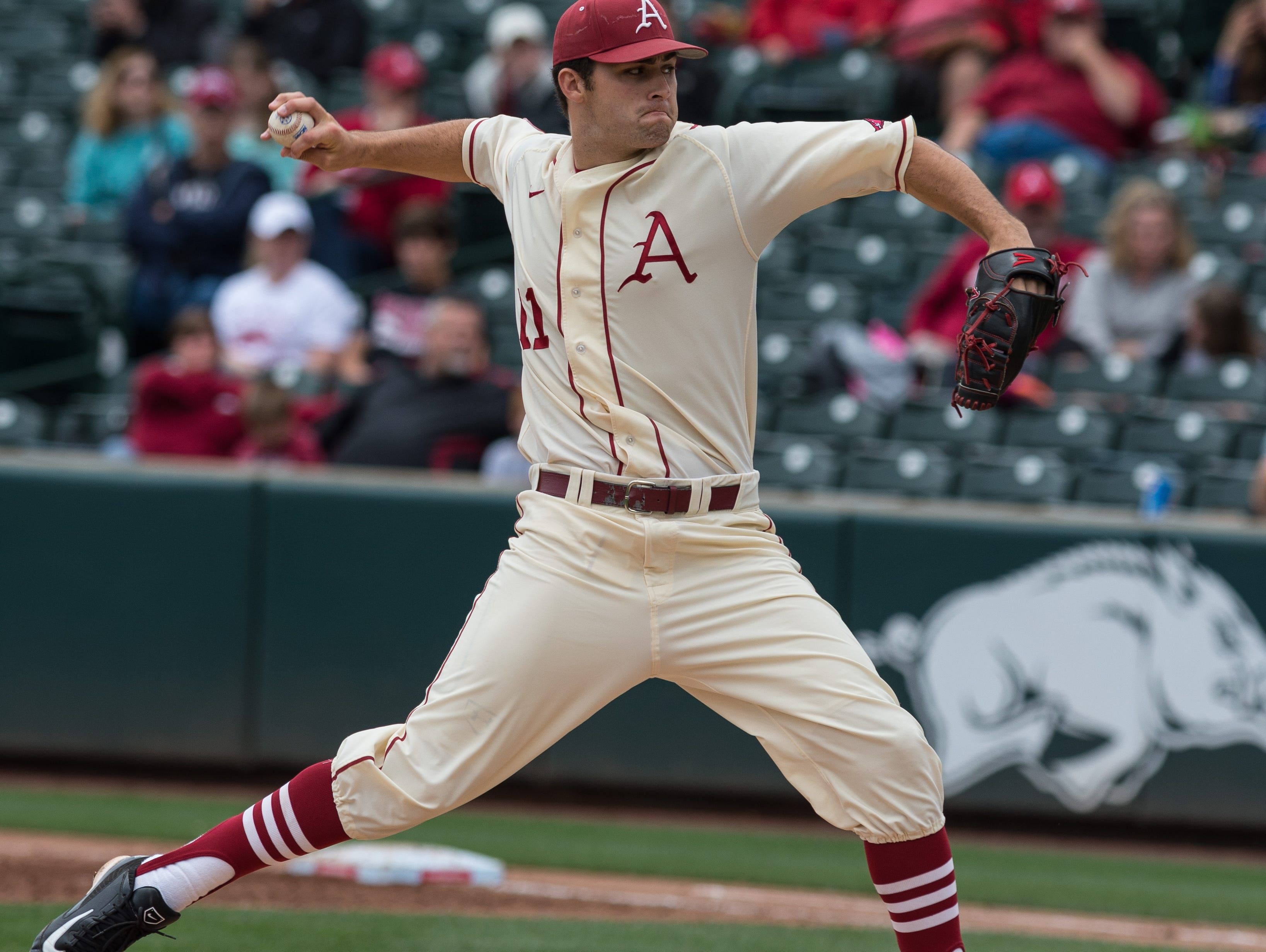 Arkansas pitcher Keaton McKinney delivers a pitch against Tennessee on Sunday at Baum Stadium in Fayetteville.