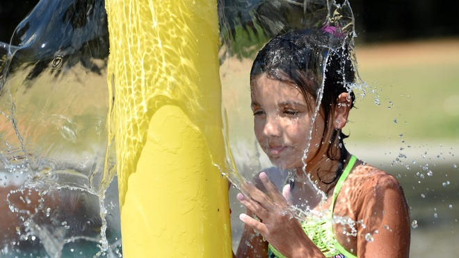 FILE PHOTO - Sophia Brown, 9, keeps cool in the spray of a water fountain at the Sprayground Splashpad at Citizens Park in Aiken, SC., Tuesday afternoon May 28, 2019.