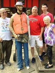 Pictured here from left to right:  Frankel's owner, Marty Frankel, Mr. Fix-All, Mike Dutkevicz, his son, Michael  and Marty's wife, Ronnie Frankel posed for a picture with Mr. Fix-All during a recent shop trip to the store for work clothes, boots and socks.