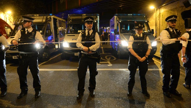 Police officers man a cordon at Finsbury Park where a vehicle struck pedestrians in London Monday, June 19, 2017. Police say a vehicle struck pedestrians on a road in north London, leaving several casualties and one person has been arrested.