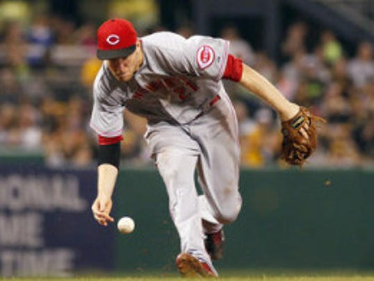 Rutgers product Todd Frazier of the Cincinnati Reds fields a ground ball barehanded in the sixth inning against the Pittsburgh Pirates during the game on September 20, 2013 at PNC Park in Pittsburgh.  (Photo by Justin K. Aller/Getty Images)