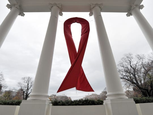This file photo taken on December 1, 2010 shows an AIDS symbol displayed on the North Lawn of the White House in Washington, DC during World AIDS Day.