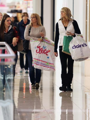 """Early shoppers make the rounds at Kenwood Towne Centre on Black Friday, Nov. 27. A reader writes to say the Thanksgiving holiday should be a day for giving thanks, not """"Thanks-getting."""""""