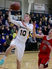 Sheboygan Christian's Jacob Stecker (10) goes in for a layup as Oostburg's Brett Ebbers (2) chases last season in a boys basketball game at Christian. The Eagles beat the Flying Dutchmen 47-41.