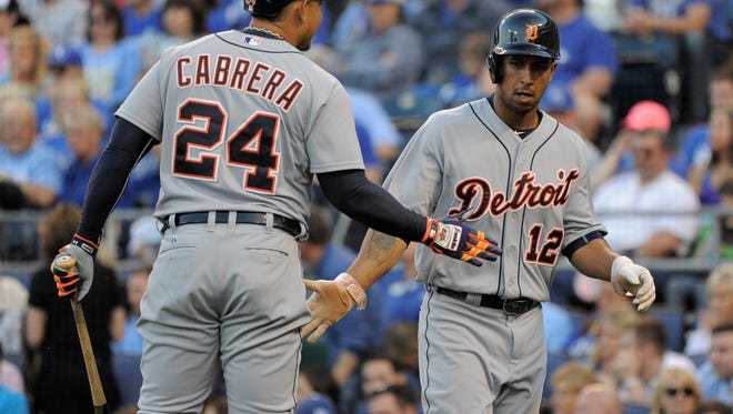 Anthony Gose #12 of the Detroit Tigers celebrates with Miguel Cabrera #24 after scoring in the fifth inning against the Kansas City Royals on May 2, 2015 at Kauffman Stadium in Kansas City.