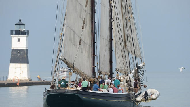 The historic tall ship fishing schooner Lettie G. Howard passes the North Pier Light at Presque Isle State Park. The Flagship Niagara League on Wednesday announced the cancellation of the sailing season for the Lettie G. Howard.
