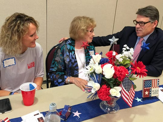 Becky Sexton, left, of Rockwell City and Blanche McMahon of Twin Lakes talk Saturday with former Texas Gov. Rick Perry. Perry appeared at an event sponsored by the Calhoun County Republican Party at the Rockwell City Community Center.