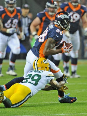 Green Bay Packers cornerback Casey Hayward (29) gives up a catch to wide receiver Demaryius Thomas (88) against the Denver Broncos at Sports Authority Field November 1, 2015.
