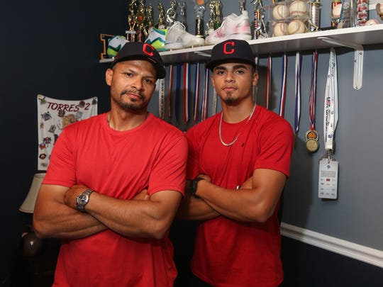 Lenny Torres with his son, Lenny Torres, Jr. at their home in Beacon on June 13, 2018.  Lenny Jr. recently signed with the Cleveland Indians.