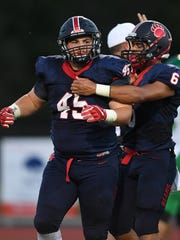 Belton-Honea Path's Austin Daniel (45), left, celebrates