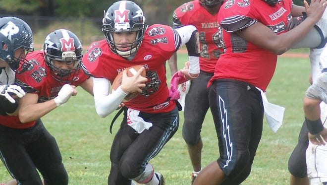 Manchester senior quarterback Antonio Biscotti (18) is hoping to lead the Falcons back to the state playoffs.