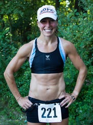 Kelly Slagh, first female overall finisher, completes