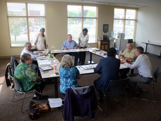 An eight-person panel — including board members, an employee, a community representative and an attorney — prepare to record their top picks for Summit Pointe's next CEO after conducting hours-long interviews with three finalists Friday at the Kool Family Community Center.