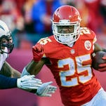 FILE - In this Sunday, Dec. 28, 2014,  file photo, Kansas City Chiefs running back Jamaal Charles (25) runs against the San Diego Chargers during the second half of their NFL football game in Kansas City, Mo. Charles was banged up much of 2014, but he said during off season work he was finally feeling healthy again. (AP Photo/Reed Hoffmann, File)