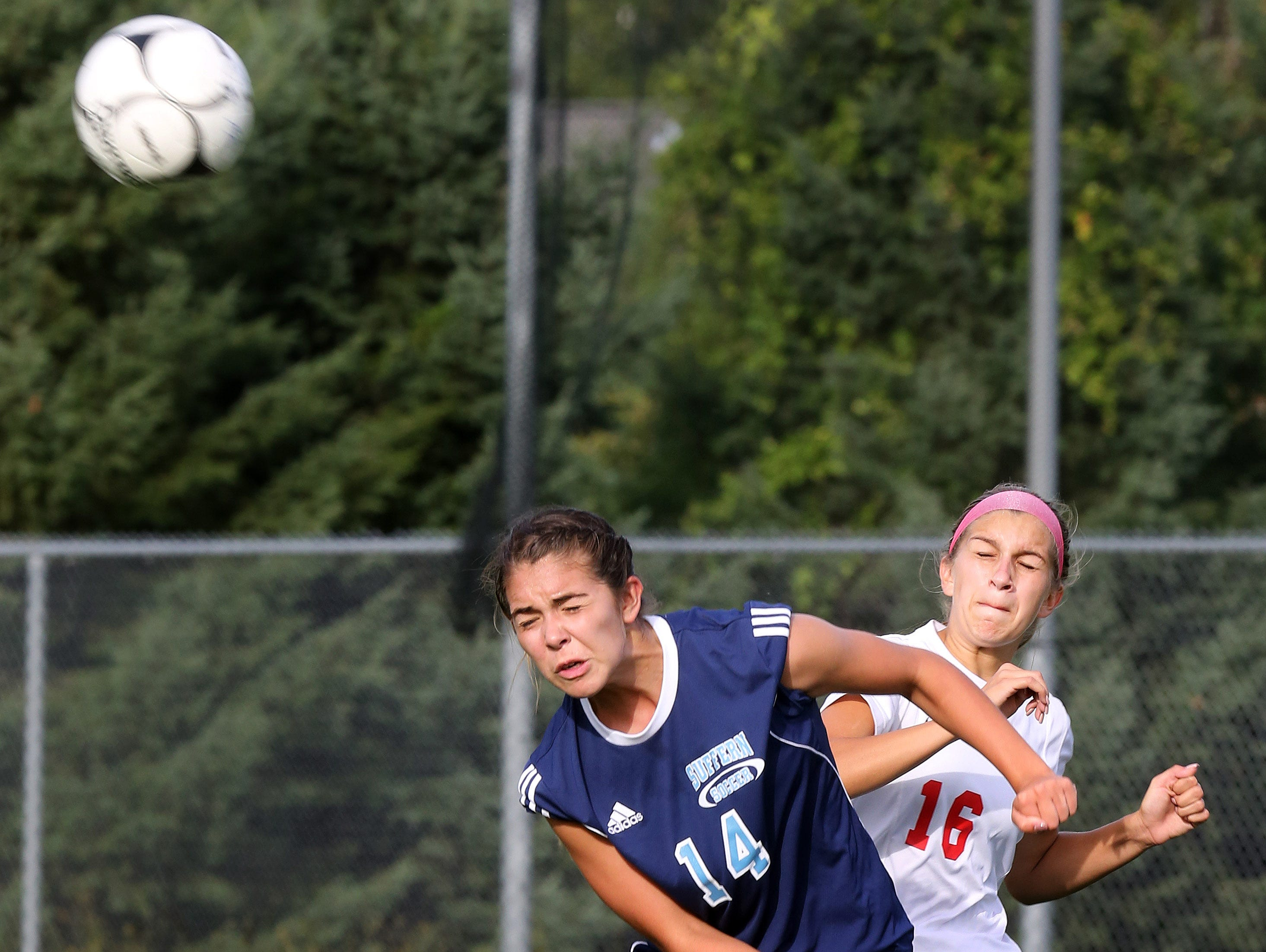 Suffern's Tatiana Cruz (14) and North Rockland's Ashley Morales (16) battle for control of the ball during girls soccer game at North Rockland High School in Theills on Sept. 21, 2016.