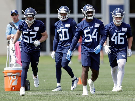 Tennessee Titans linebackers Robert Spillane (52), Chequan Burkett (50), Rashaan Evans (54) and Nick DeLuca (46) during NFL football rookie minicamp Saturday, May 12, 2018, in Nashville, Tenn.