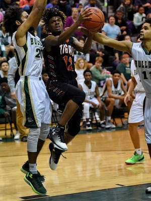 Senior guard Tuzion Brock (12) and the Southside Tigers are No. 1 in Class AAA in the preseason rankings.