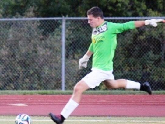 South Lyon goalkeeper Jack Dalzochio moved to forward the second half and assisted on both goals.