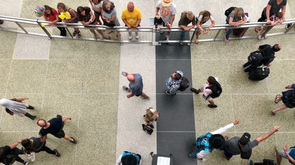 Travelers arriving at Denver International Airport