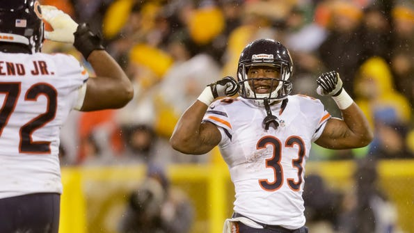 Bears running back Jeremy Langford reacts after scoring