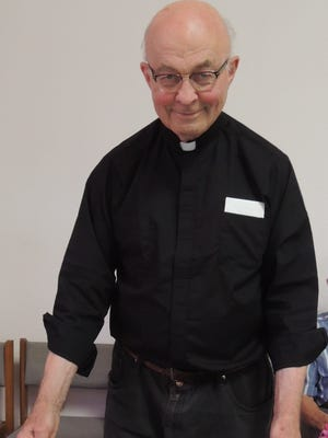 Father Milton Suess celebrates his 80th birthday at St. Mary Catholic Church in Luxemburg.