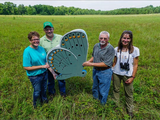 Pictured are (from left) Jennifer Roetter (Altoona NRCS District Conservationist), Andy Bourget (retired FSA County Executive Director (CED)), Jeff Myers (current FSA CED) and Paula Kleintjes Neff, PhD and Professor of Entomology and Conservation Biology at University of Wisconsin Eau Claire.