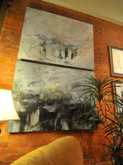 Arts hang on the wall of Allister Deacon's Coffee House in downtown Wausau.