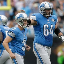 Detroit Lions kicker Nate Freese (3) is consoled by Travis Swanson after missing a field goal against the Carolina Panthers in Charlotte, N.C., on Sunday, Sept. 14, 2014.