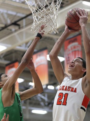 Kaukauna's Donovan Ivory, right, goes to the basket against Oshkosh North during a game earlier this season in Kaukauna.