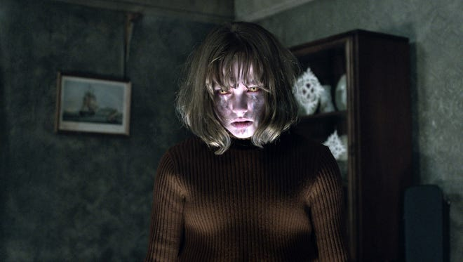 """This image released by Warner Bros. shows Madison Wolfe in a scene from the New Line Cinema thriller, """"The Conjuring 2."""""""