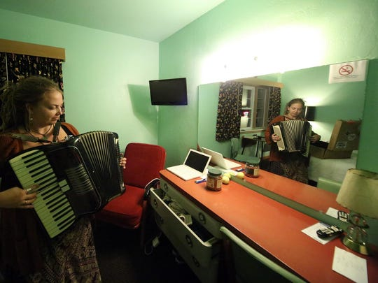 """Carley Baer and her accordion work on a piece for """"Dark Songs"""" in a room at the Holiday Music Motel."""