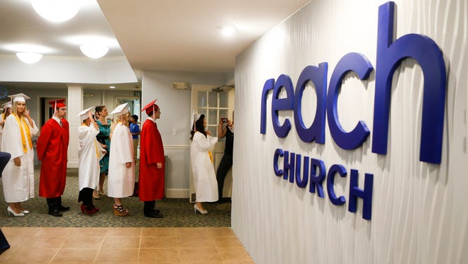The class of graduates files into the sanctuary as Red Lion Christian Academy hosts commencement for the 35 graduates of the class of 2017 at Reach Church. Reach recently acquired another school, Tri-State Christian Academy in Elkton, Maryland.