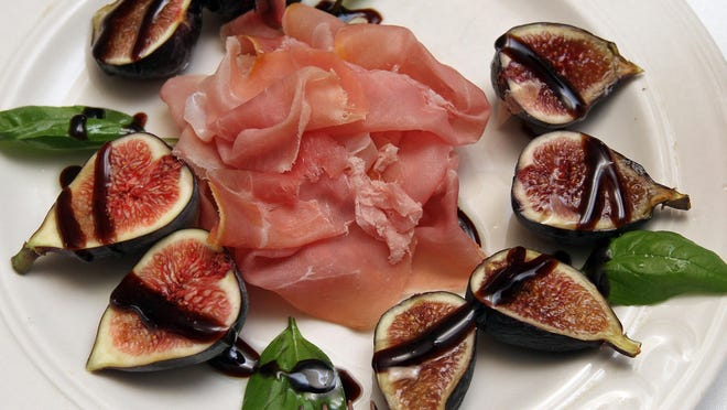 Vincenzo's Ristorante in Middlesex is owned by Rui Alves. This is their figs and prosciutto dish.