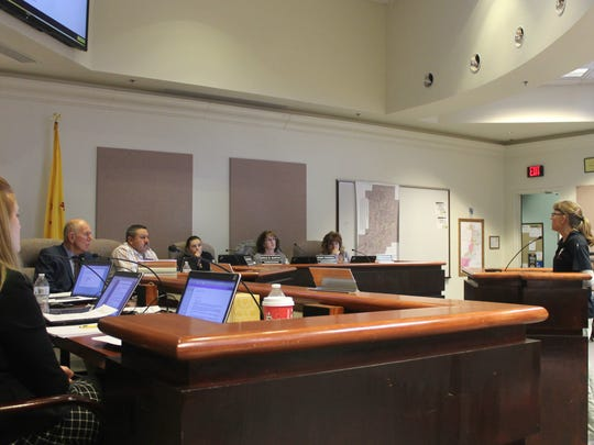 The City Commission listens as Diana Driscoll, local apartment manager, voices her concerns over the city's utility system.
