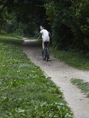 A cyclist hits the Old Croton Aqueduct trail