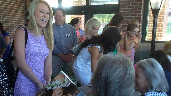 Miss Mississippi contestants check in for pageant which begins Wednesday.