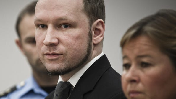 Norwegian terrorist and right wing extremist Anders Behring Breivik, center, appears in court, Friday, August 24, 2012, in Oslo, Norway.