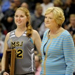 Lauren Hill (left) was awarded the Pat Summitt Most Courageous award by the board of directors of the United States Basketball Writers Association in November of 2014. Summitt (right) was in attendance but did not speak publicly. The award, typically given out during the Women's Final Four, was presented early, just as Mount St. Joseph's game vs. Hiram was accelerated so Hill could play. Hill had an inoperable brain tumor and died April 10, 2015.