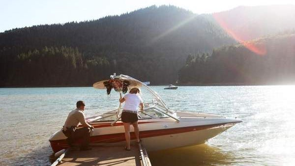 Linn County deputy sheriff Jason Smith inspects a boat at Green Peter Reservoir.