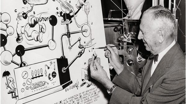 Goldberg later in life drawing one of his large cartoons.