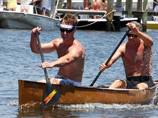 Cacey and Pete Janks, a father and son team, in the lead and winners of the Practically Professional category at the 34th Annual Great Dock Canoe Race.