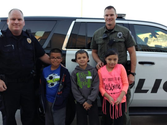 Mesquite Police Officers Steve Bruehl, left, and Jaime Stout participated in this year's Shop with a Cop event with local schoolchildren.